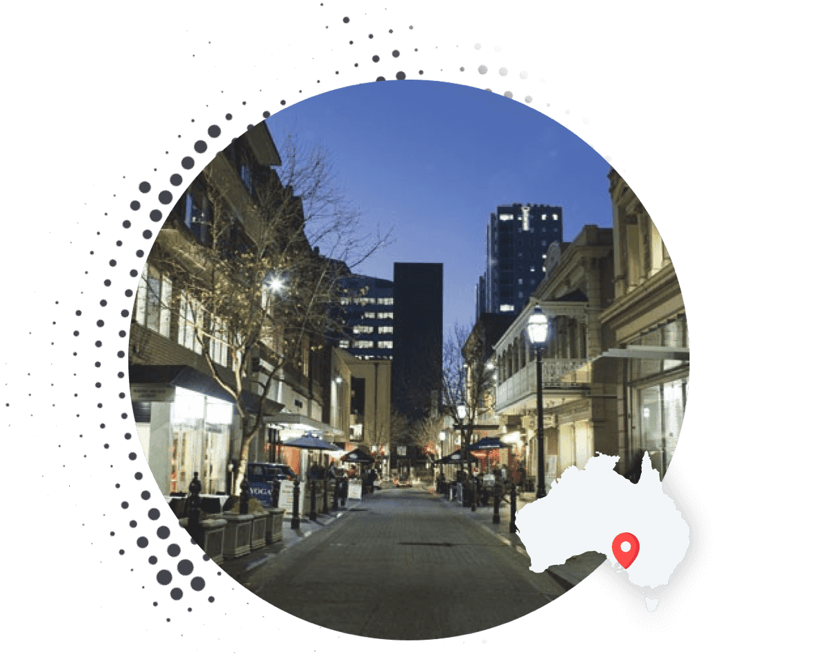 Leigh Street, Adelaide at night displayed in a circle mask with map of Australia overlaid and location pin highlighting Adelaide. Kentico Agency | The Digital Embassy.